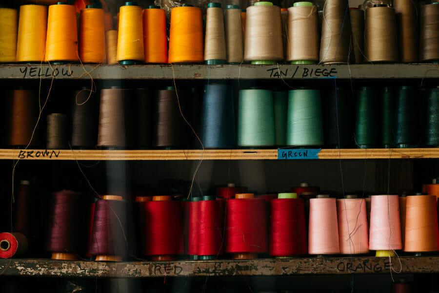 multi-colored spools of thread